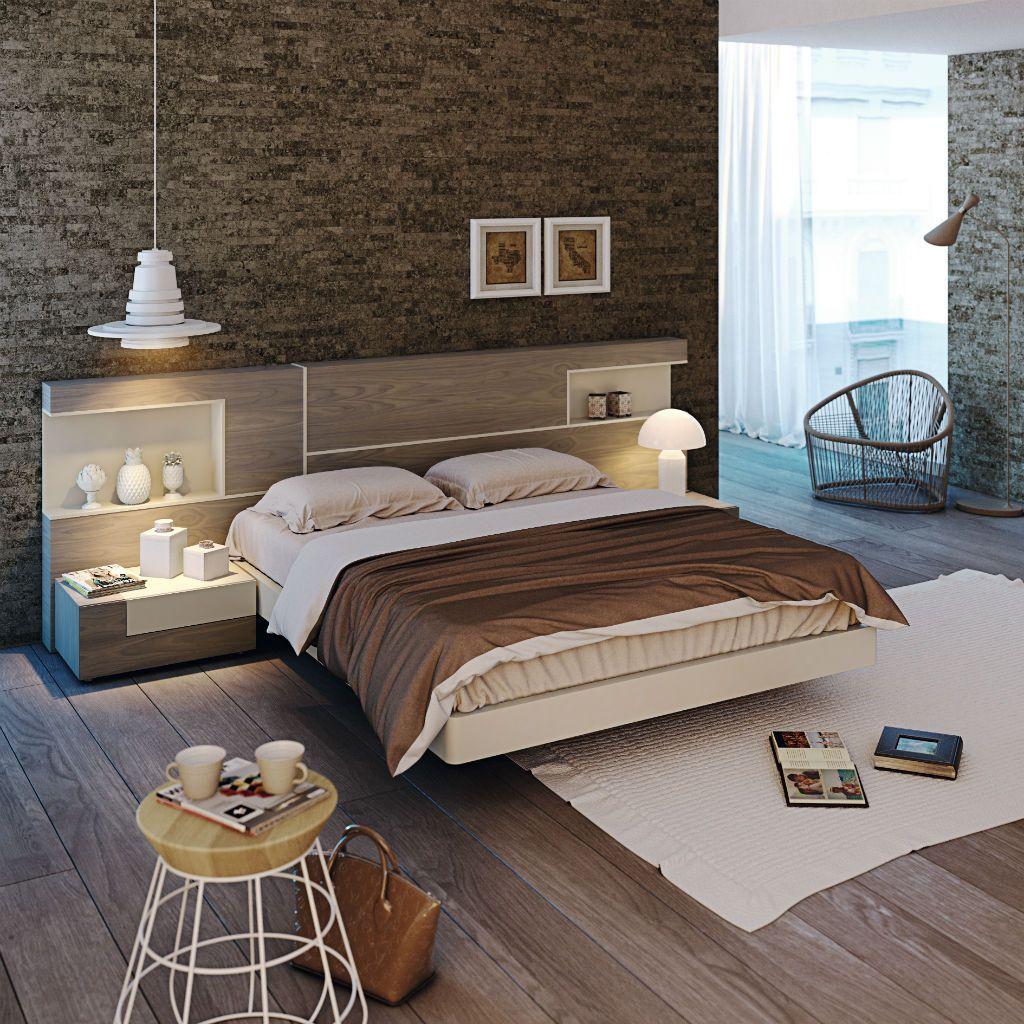 Dormitorio de matrimonio moderno con pared de piedra for Camas infantiles diseno moderno