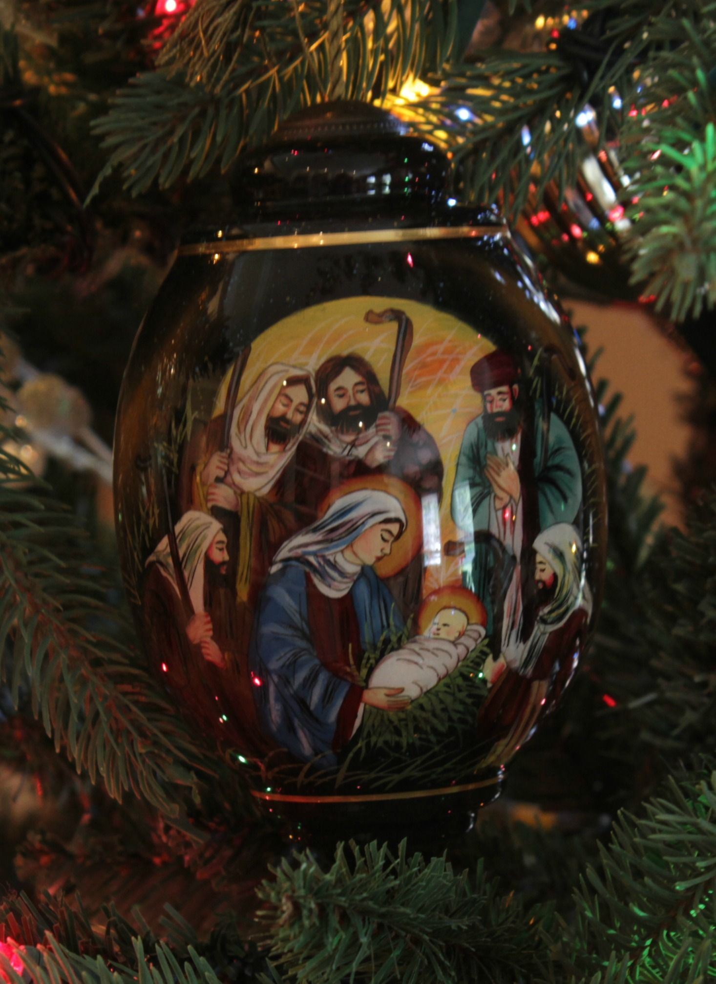 this nativity scene ornament is hand painted using an ancient