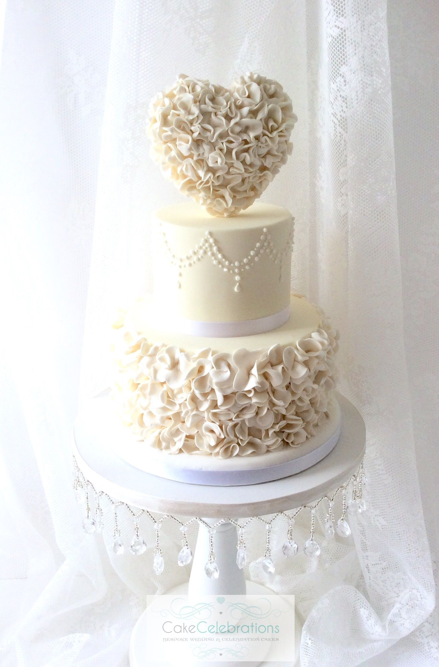 A romantic twist on a traditional white 3 tier wedding cake with ...