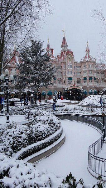 Disneyland Paris Under Snow, France. I went with my college when it snowed. So beautiful!