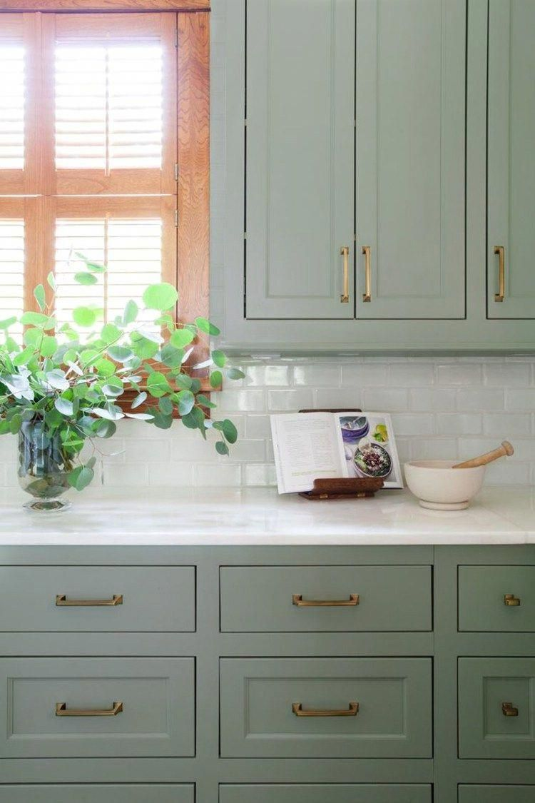 Sage Green Kitchen Cabinets With Brass Hardware And White Subway Tile Backsplash Painted Kitchen Cabinets Colors Green Kitchen Cabinets Kitchen Cabinet Colors