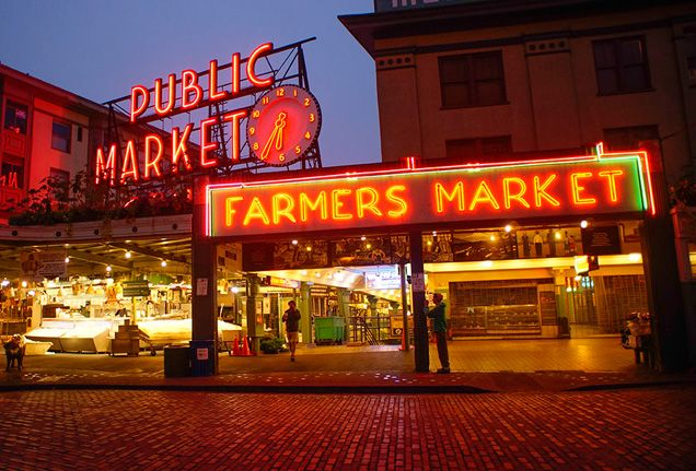 """One of #FSJet Concierge Bertine Hage's favourite places to visit in Seattle is Pike Place Market. """"I love strolling through this vibrant market to discover stall after stall of meticulously arranged local apples; fat, round cabbages; local crafts; and buckets of dahlias and sunflowers—a scene worthy of a still life."""""""
