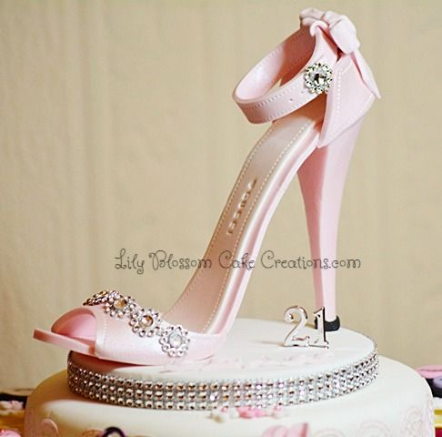 A stunning Pink Stiletto Cake topper and Cupcakes designed for your special lady's birthday.
