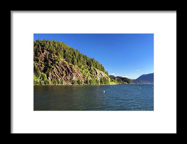 Alex Lyubar Framed Print featuring the photograph A Cliff Over The Sea by Alex Lyubar #AlexLyubarFineArtPhotography #VancouverCanada#StraitOfGeorgia#SunnyDay#Seascape#Cliff#RockyIsland#BlueSky#ArtForHome #FineArtPrint#ArtPrintForSale