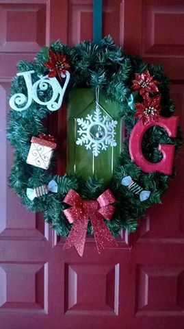 Home made wreath  Dollar Tree Ornaments &a Wreath & letter from Michaels