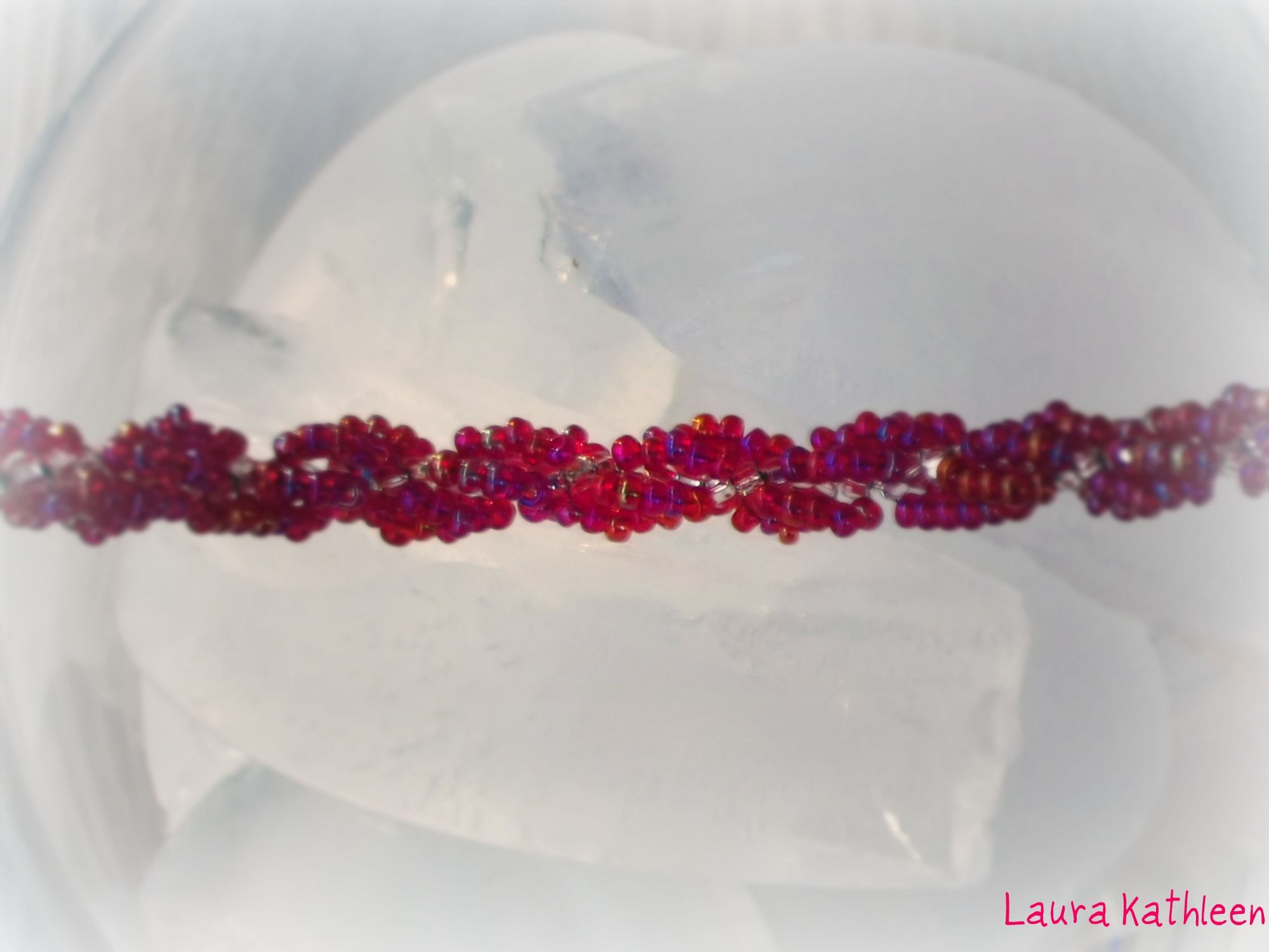 """""""Raspberries & Ice"""" Swirl Weave Peyote bracelet--not a very good picture, but you would be surprised at how hard it is to find a good backdrop for those colors together!"""