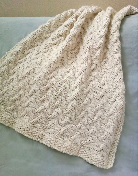 I wanted to create a timeless, creamy baby blanket in a simple cable ...