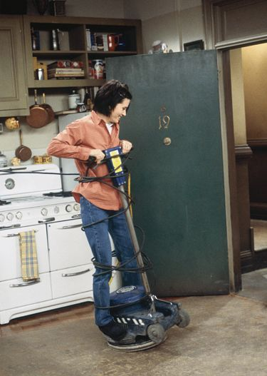 Monica Geller (Friends TV Show) riding a floor buffer