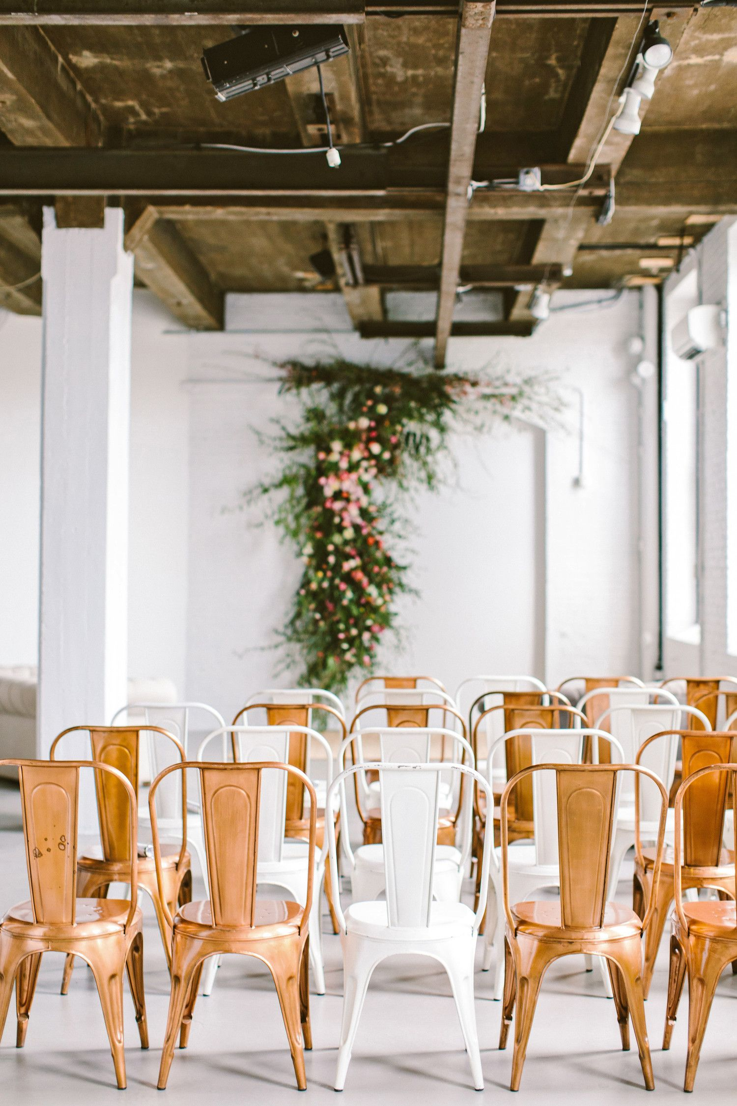 Painted And Copper Plated Metal Chairs From Maggpie Rentals Filled The Ceremony Space At Crane Ar Wedding Rental Chairs Wedding Chairs Wedding Budget Planner