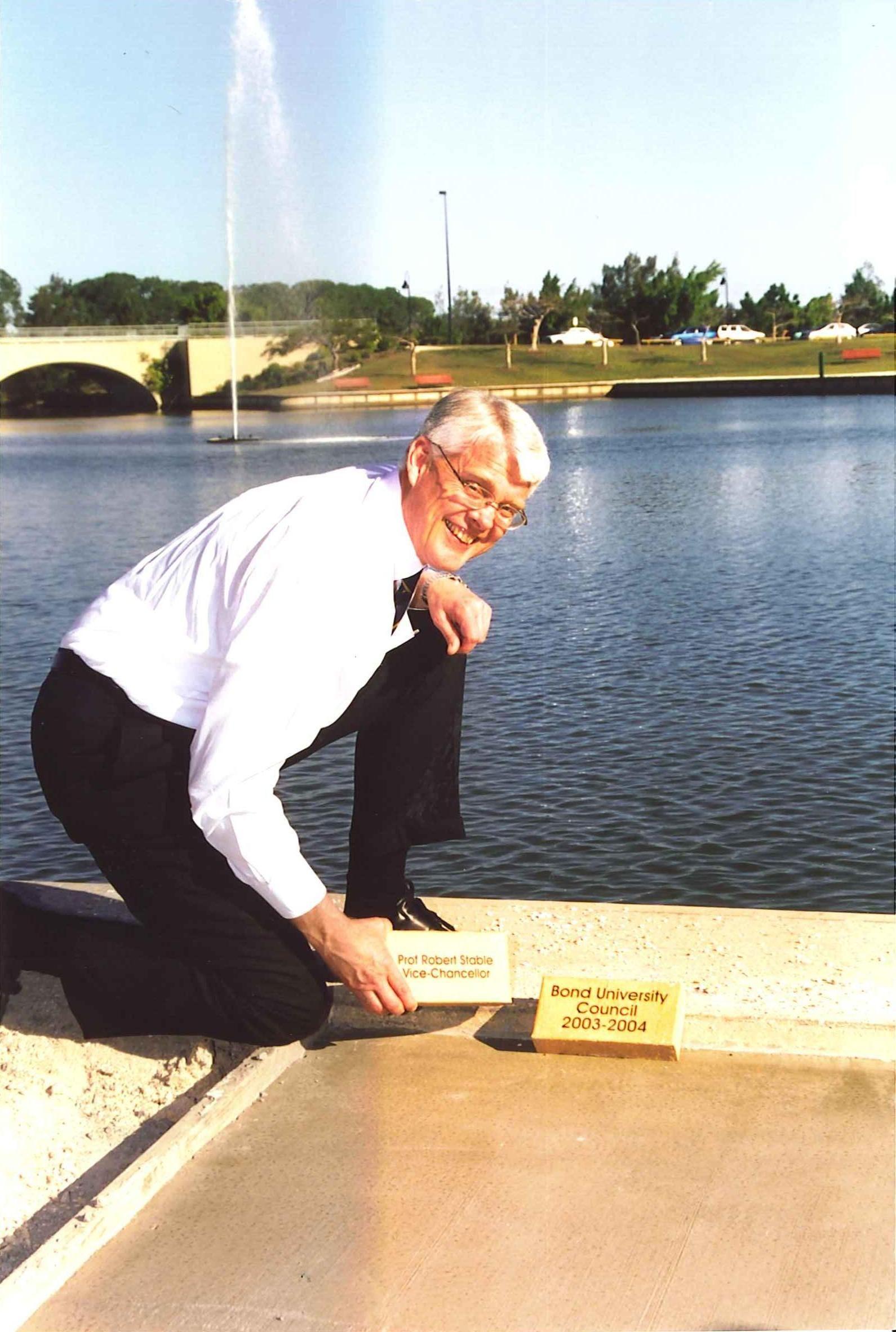 Emeritus Professor Robert Stable laying the first pavers at Bond University