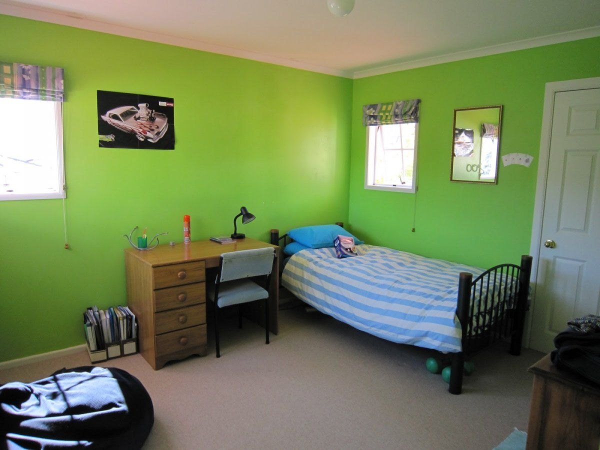 A Simple 12 Year Old Boys Bedroom With Blue Striped Bed And Wooden Cabinet Also A Bean Bag In Green Colo Bedroom Colors Kids Bedroom Designs Boy Bedroom Design