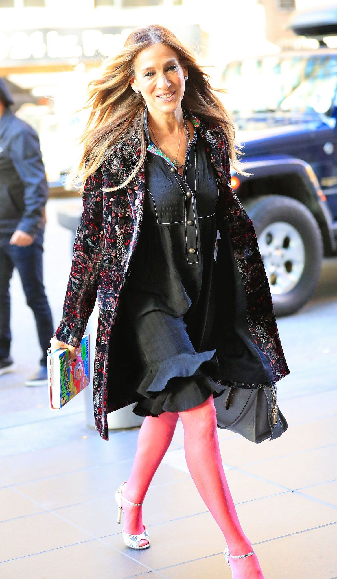 Sarah Jessica Parker looks effortlessly chic at JFK