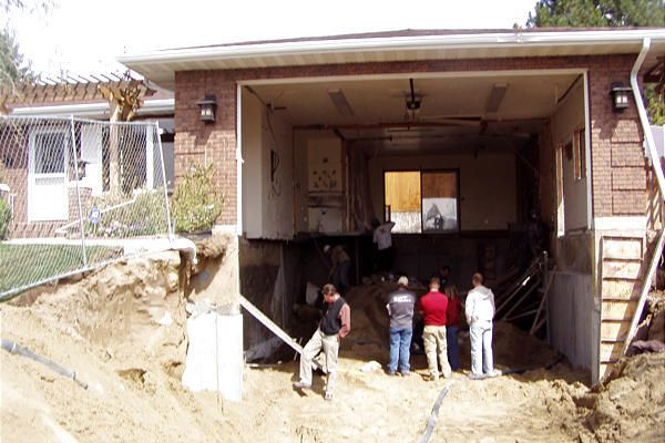 Renovation Solutions Digging Down Erases Steep Driveway Deseret News In 2020 Driveway Landscaping Driveway Design Front House Landscaping