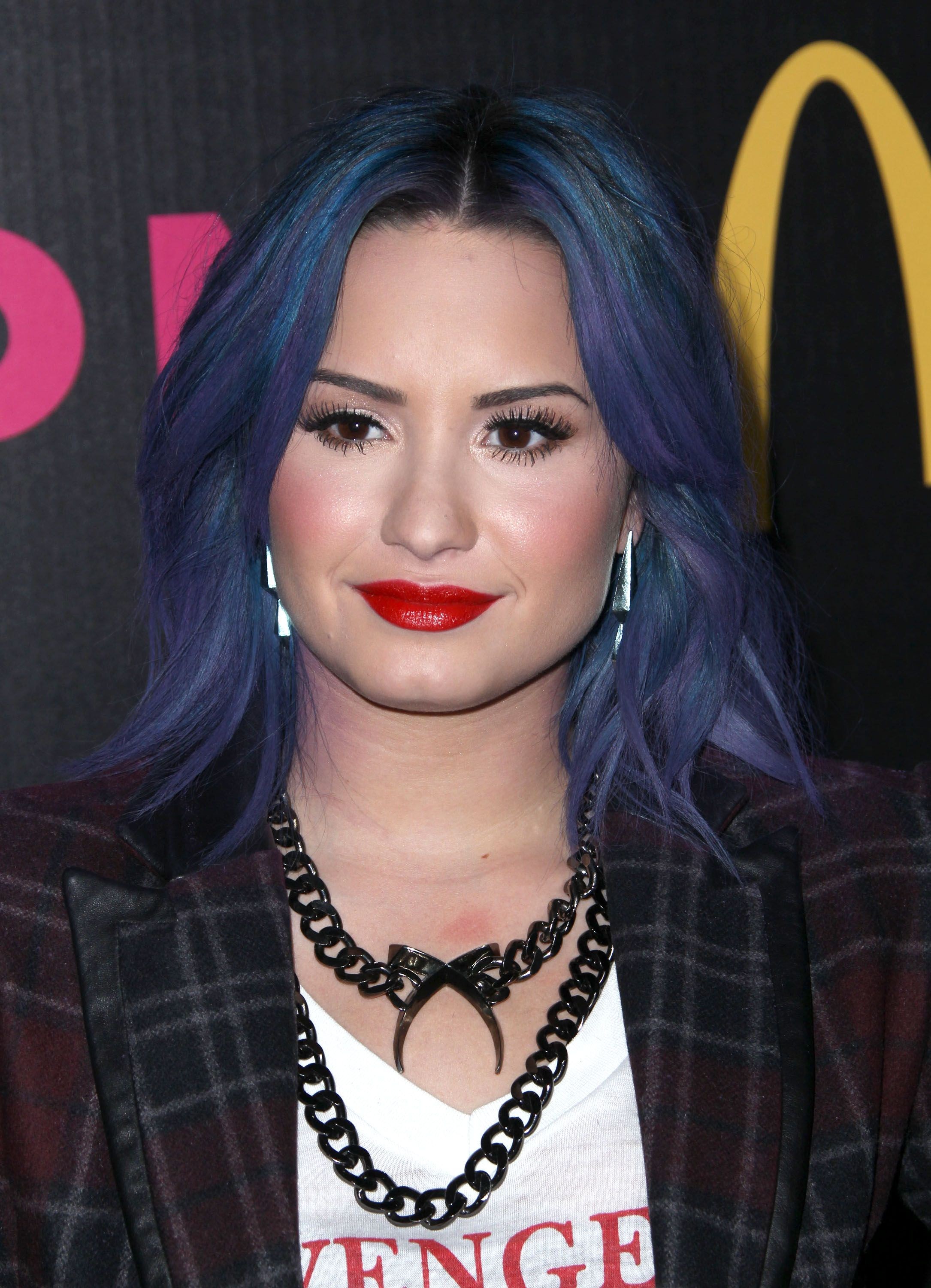 Demi Lovato shower off her new blue and purple hair color with a ...