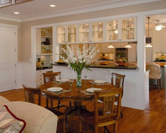 Open kitchen wall with glass cabinets great way to for Formal dining area