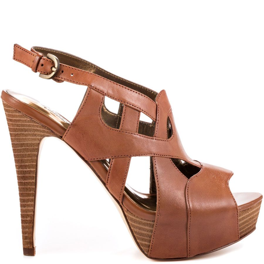 Say goodbye to bad fashion and say hello to the Ciao. Carlos by Carlos  Santana showcases a tan leather cut out sandal with adjustable heel strap.
