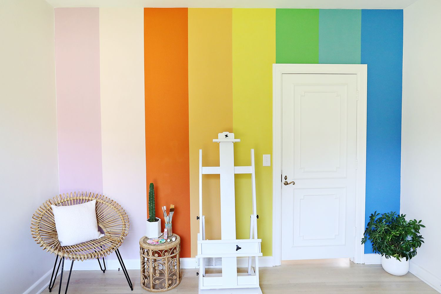 DIY rainbow wall with chalk paint! See more on ABeautifulMess.com ...