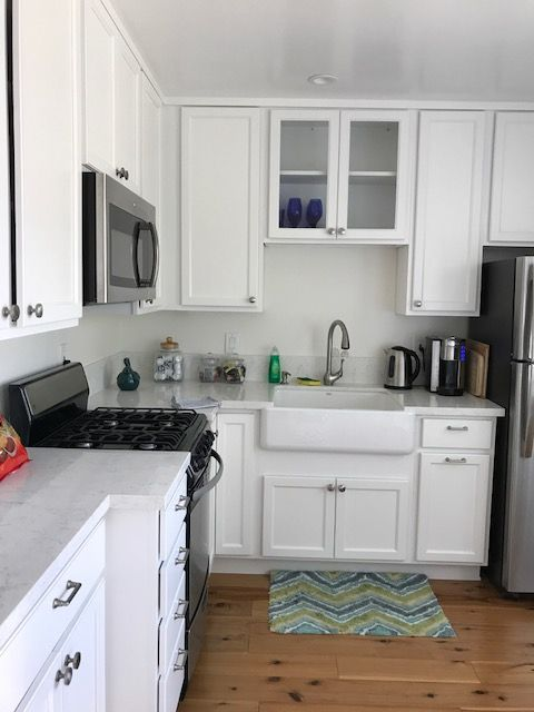 All White with wood floors. stainless appliances. | Beach ...