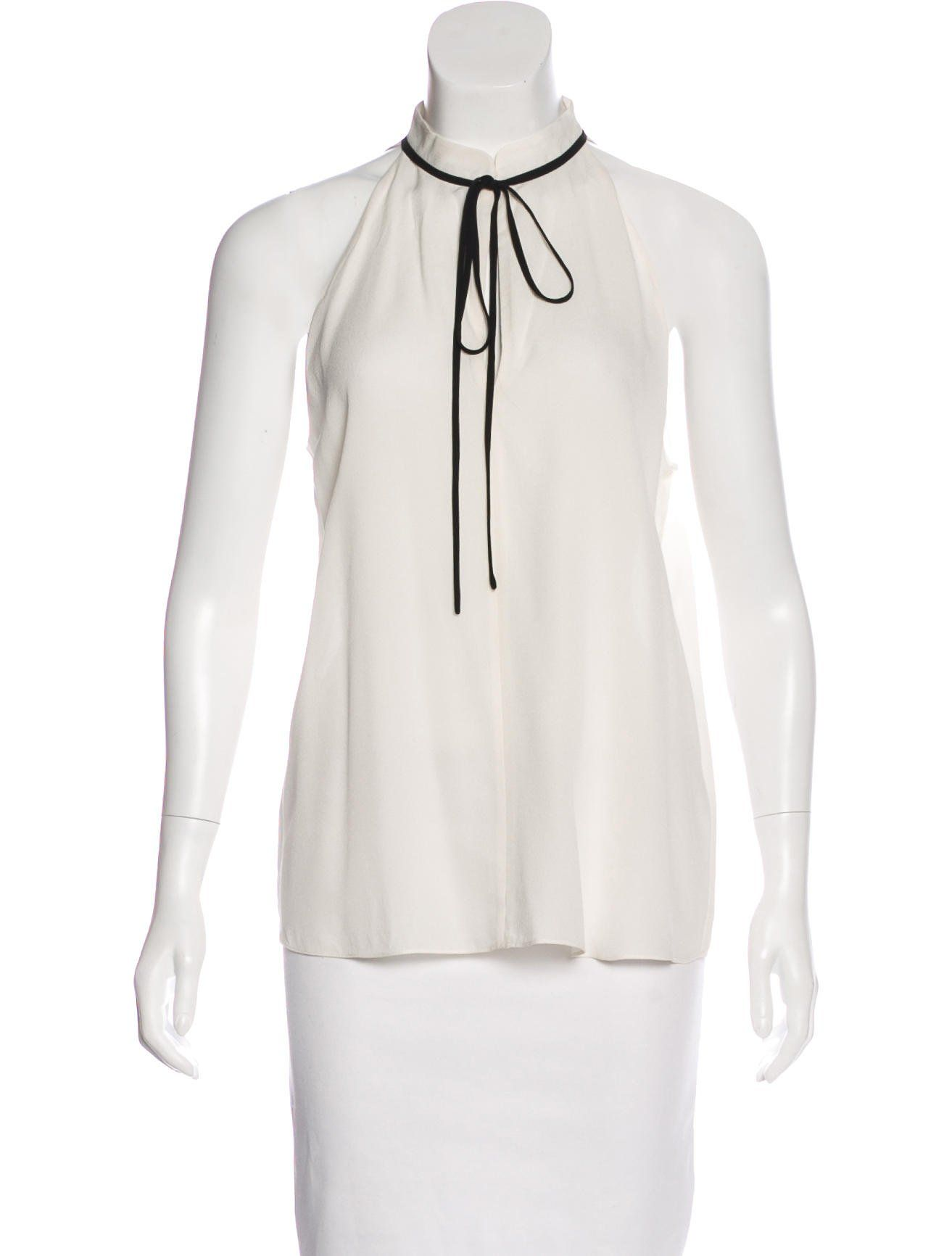 00ebd7172 Ivory and black A.L.C. silk sleeveless blouse with V-neck, sash tie at bust  and tonal stitching throughout.