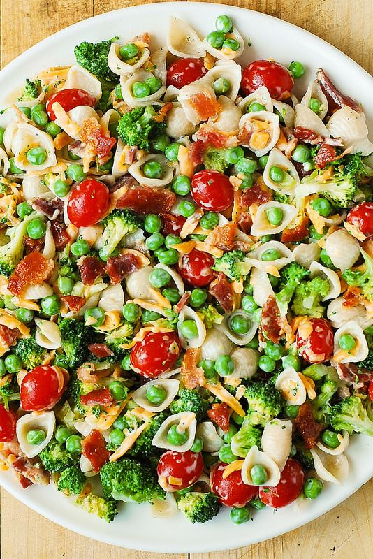 This easy pasta salad recipe is perfect for a quick dinner. Broccoli, peas, cherry tomatoes, bacon and (of course) ranch come together for a beautiful pasta salad with dynamite flavor!