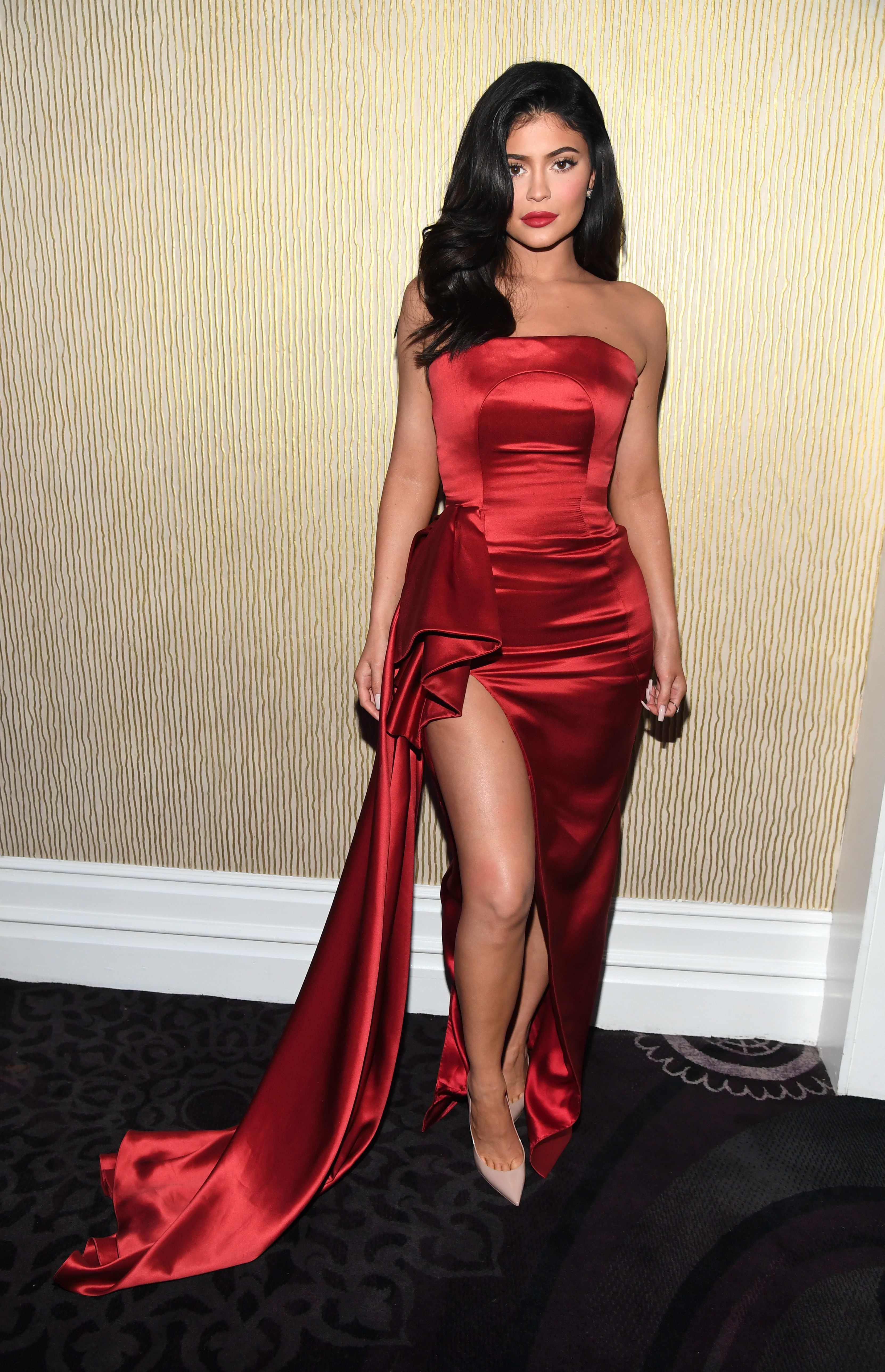 Kylie Jenner Is Being Praised By Fans For This Video Of Her Styling Stormi S Natural Hair Here Kylie Jenner Red Dress Kylie Jenner Dress Celebrity Prom Dresses