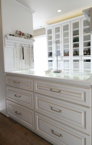 Center Island Of Jewelry Drawers With A Glass Countertop So You Can See Into The Top Drawers And An Entire Custom Closet Design Closet Remodel Closet Designs