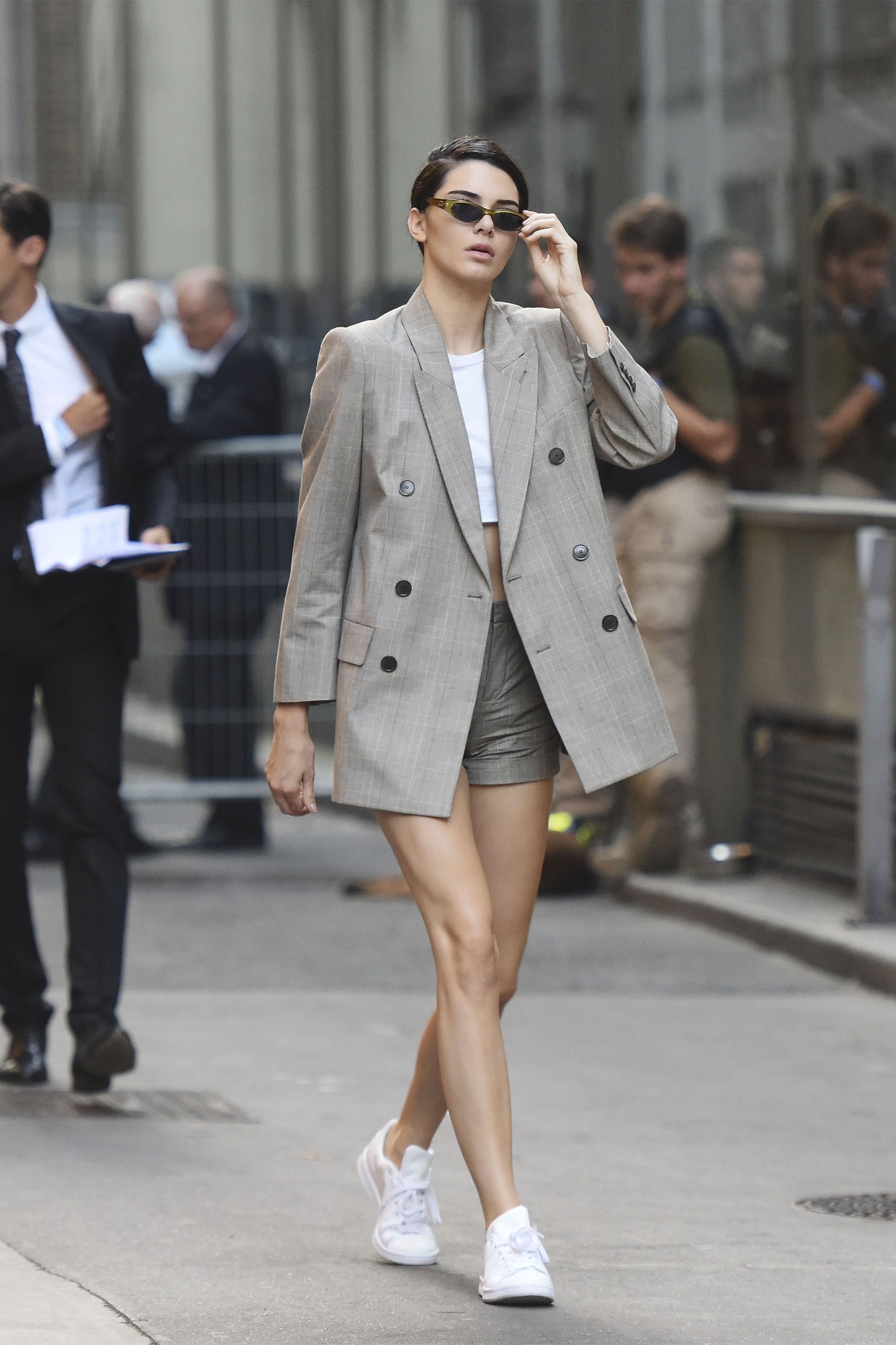 45b88c35cf41 Kendall Jenner makes us believe in the shorts suit by pairing an oversized  blazer with high-waisted shorts and Adidas Stan Smith sneakers.