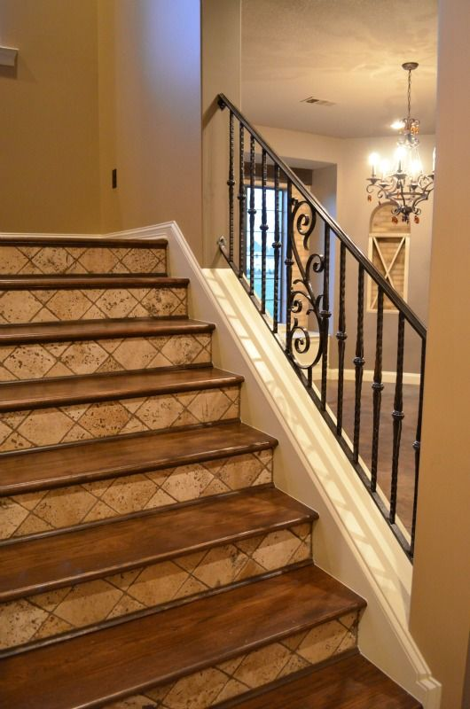 Iron Railing Tumbled Tile Risers And Stained Wood Treads   Stair Riser Tiles Designs