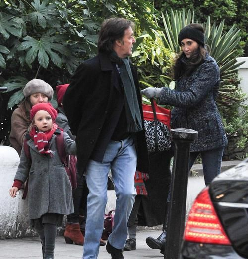 Paul McCartney And His Wife Nancy Shevell With One Of Pauls Grandchildren