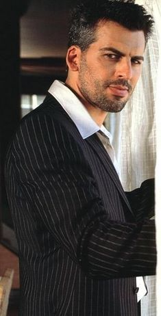 Oded Fehr. Possibly could work as the Persian? Canonically, in the book, he's described as the most attractive male character.