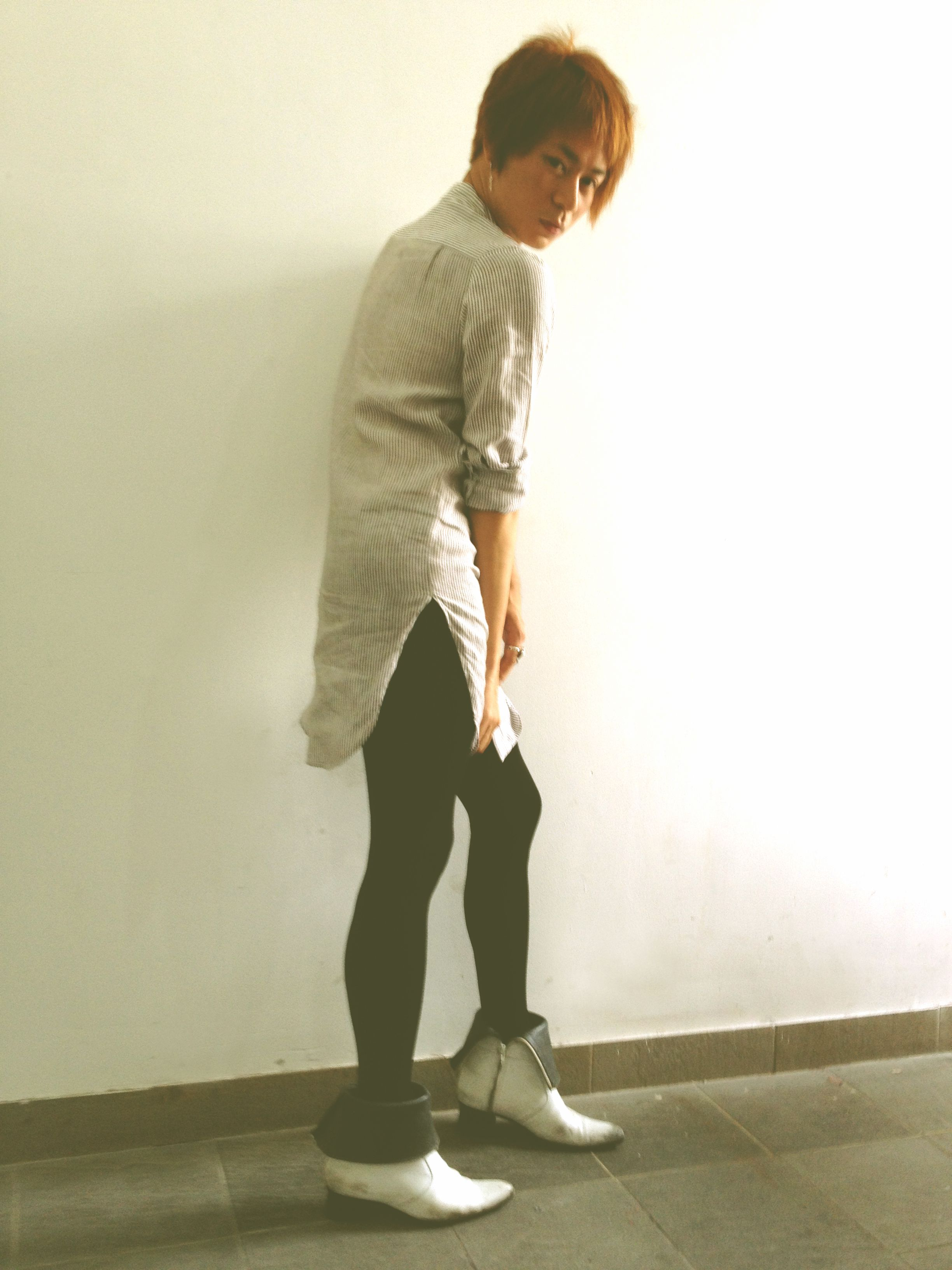 "Style guide: The Court Jester ~ Wednesday at work. ""Legging was first worn by men since the Medieval ages, and society said women lead fashion. I vote for fashion equality, do you dare to wear?"" Valentine Vu #fashion #legging #boots"