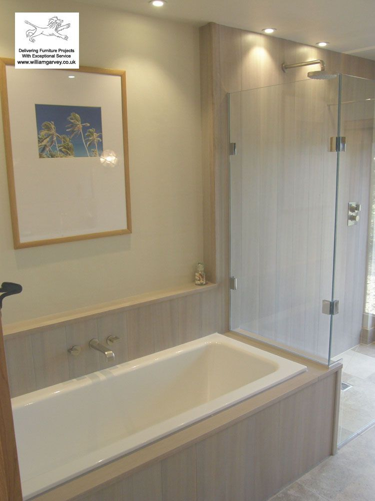 Grey Stained Waterproof Teak Tiles On The Shower Wall And Bath Surround