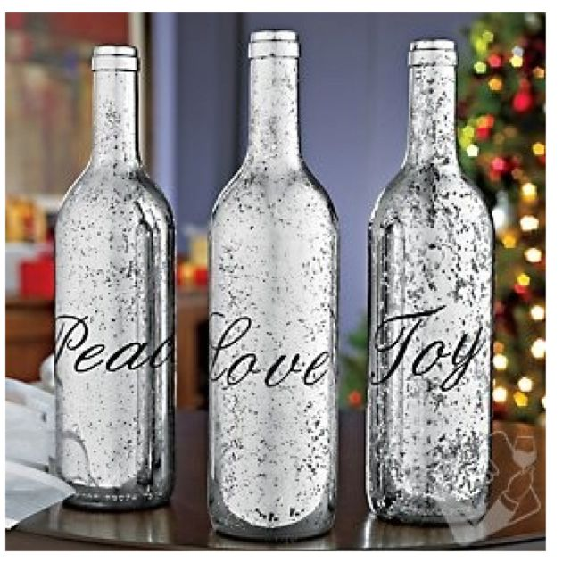 silver paint spray to repurpose wine bottles as lovely mercury-like holiday decorations