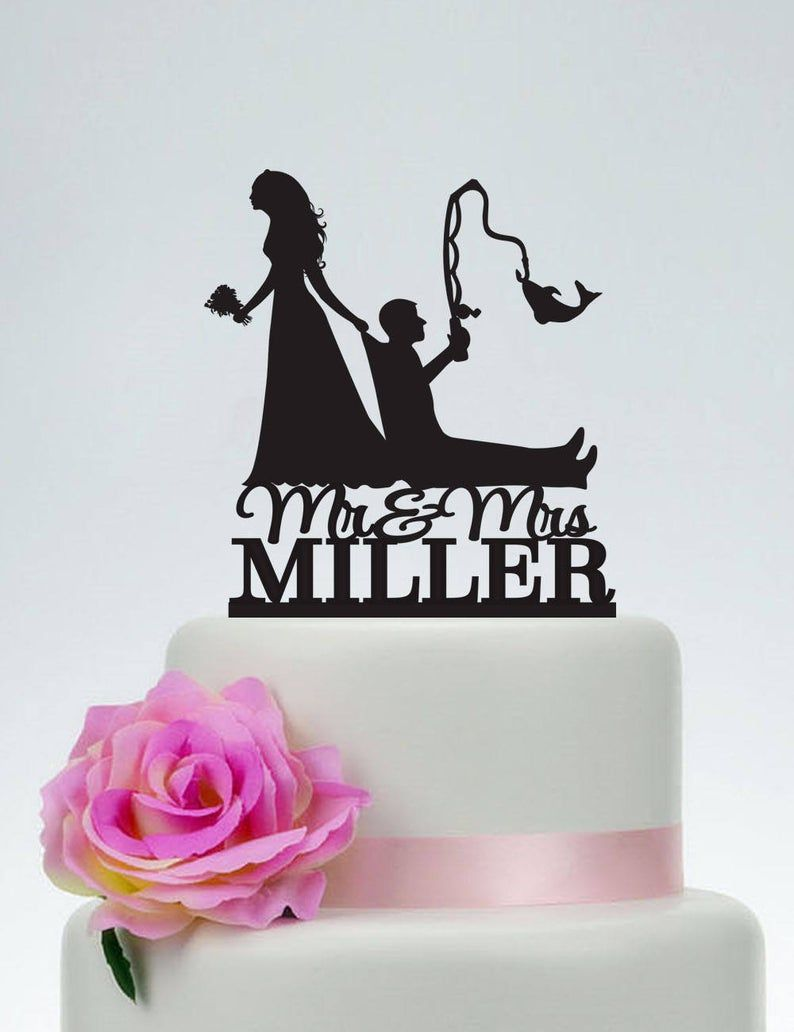Bride pulling groom bride dragging groom funny cake topper