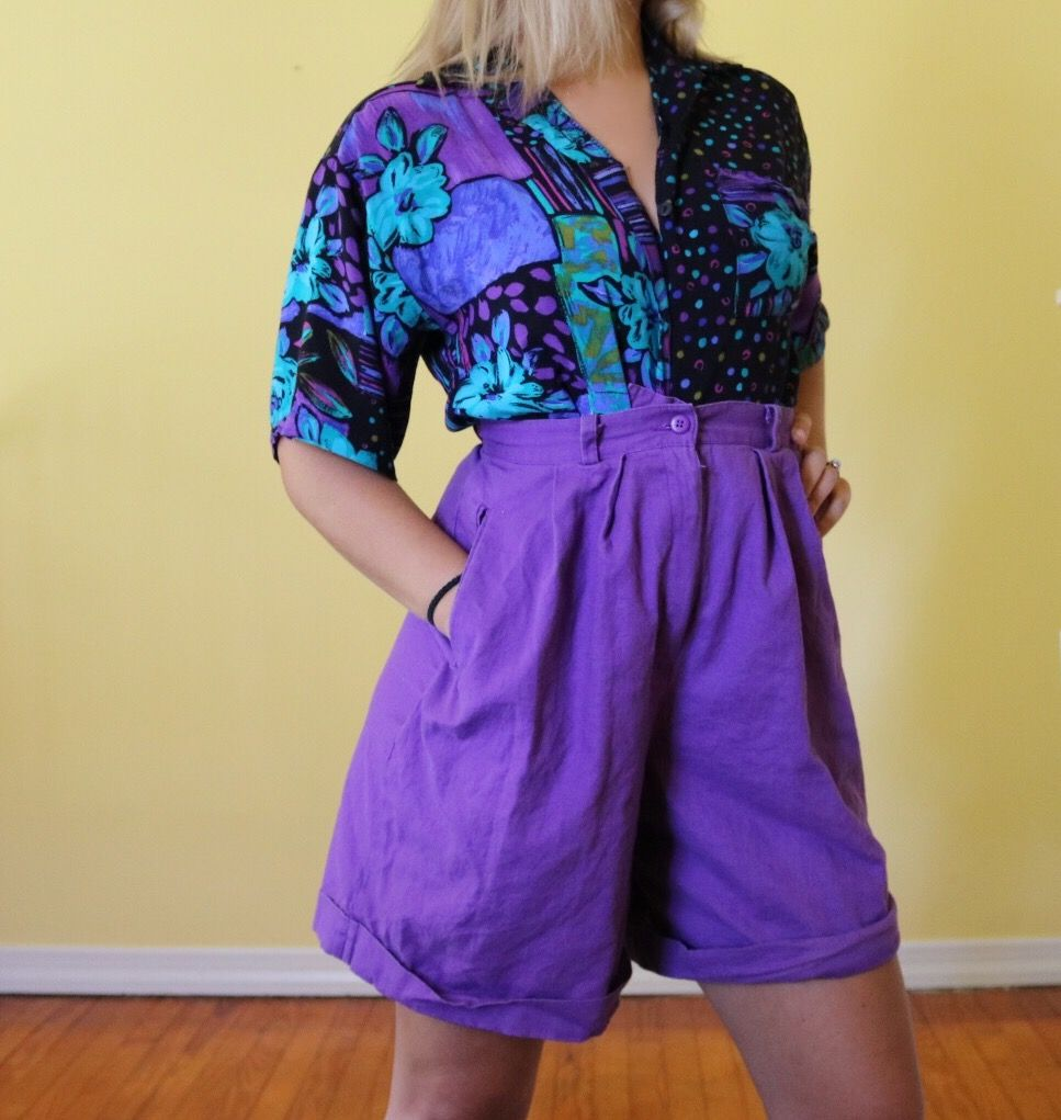 1ca1ff42192 Super cool vintage 80s fashion outfit. Bright purple high waisted hot  pants. Standout bold print vintage 80s button up top. Colorful vintage  clothing.