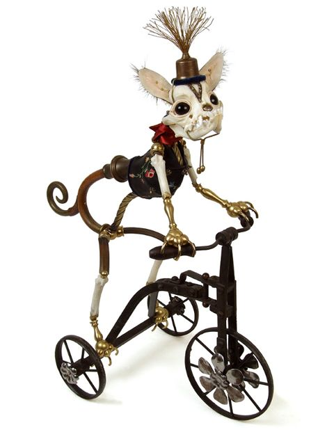 Steampunk cat on a tricycle by Jessica Joslin.