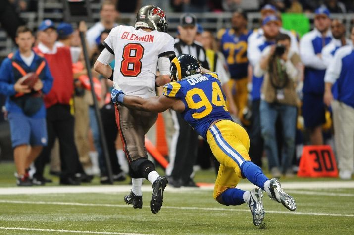 Robert Quinn gets his 18th sack of the season during a game against the Tampa Bay Buccaneers at the Edward Jones Dome. Quinn set a new STL Rams record for sacks with #18, passing Kevin Carters 17 sacks set back in 1999.  12-22-13