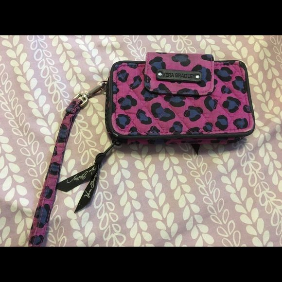 Authentic Vera Bradley Wallet/Phone case Used Vera Bradley wallet has a lot of space and can store a phone in the front. :) Vera Bradley Bags Wallets