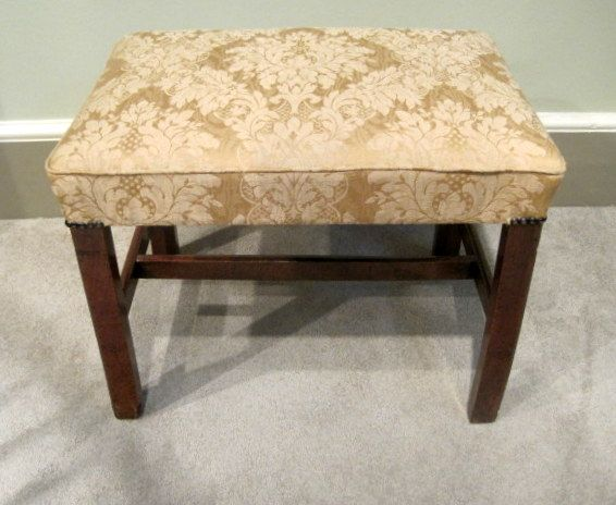 A fine Chippendale period mahogany stool, with stuff over seat on square chamfered legs united by stretchers. Circa 1770.