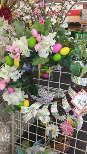 Hydrangeas and tulips with hidden easter eggs. Cute fun bow wrapped around.