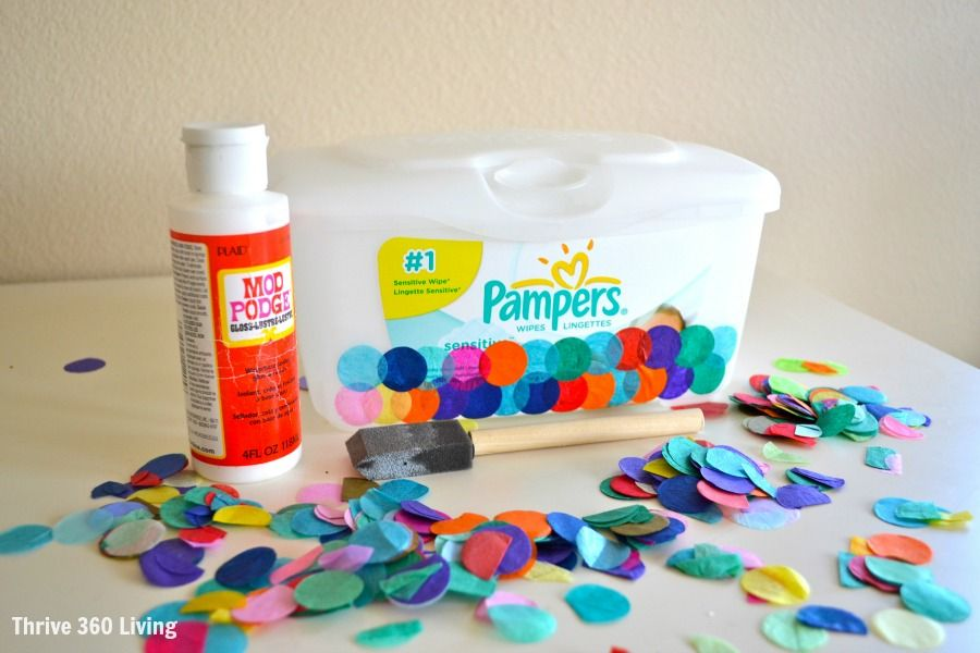DIY Confetti Covered Storage made using a diaper wipes container.