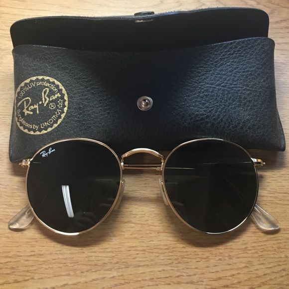dbec81c75a4 Shop Women s Ray-Ban Black Gold size OS Sunglasses at a discounted price at  Poshmark. Description  Ray ban round sunglasses. Black lenses with gold  frames.