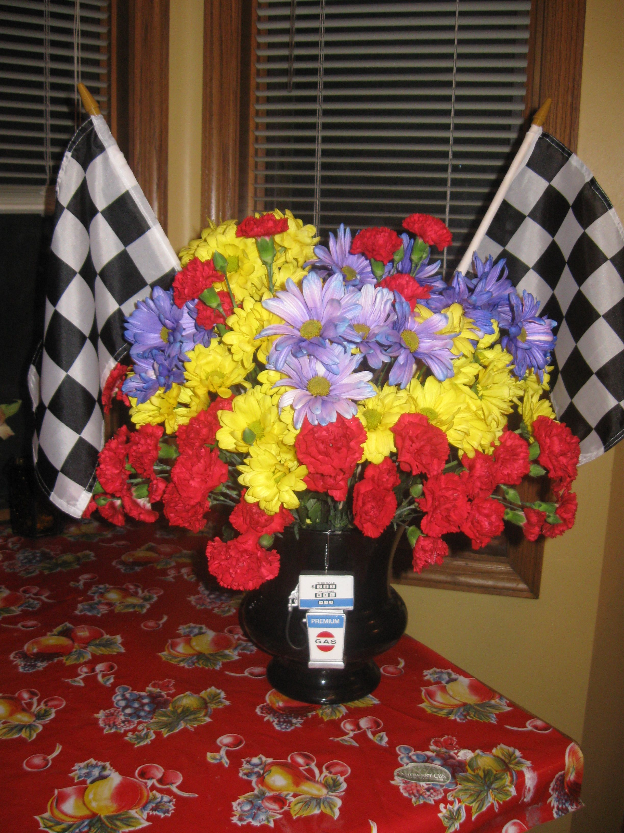 This arrangement was for a Nascar enthusiast. It had the bright ...