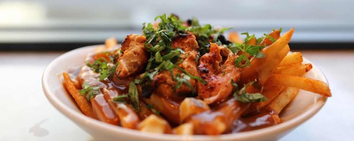 The Badmaash brothers make their poutine by tossing the fries in a paprika masala and Indian rock salt, topping the whole dish with tandoori chicken tikka.