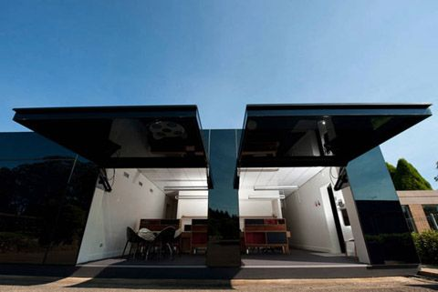 'Modern work spaces can be constructed or redesigned – this next project is part of the latter- a former machinery shed was redesigned to suit a modern office lifestyle. Named the Black Box, this black glass-covered volume was completed in February 2012. As a result of a fruitful collaboration between Tina Tziallas Architecture Studio and Factor Design, the Black Box in Wildes Meadow, Australia, was created for a software design studio. High-performance tilt doors open to reveal a powerful…