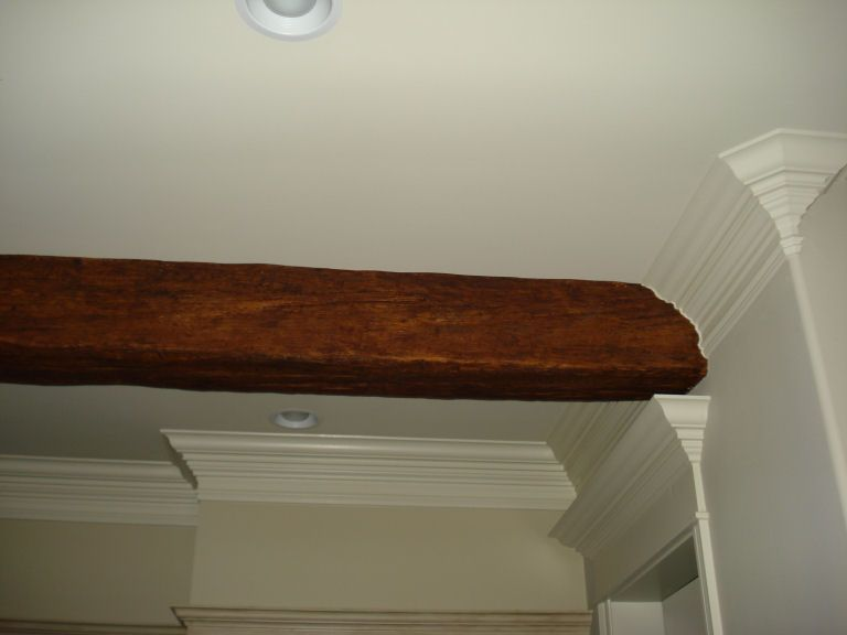 Scribing Blends Beams Into Crown Molding Faux Wood Workshop Small Basement Remodel Faux Ceiling Beams Beams Living Room