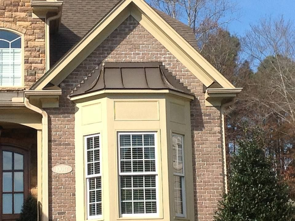 Metal Roof Over Bay Windows In Raleigh Metal Roofs Can Be Used As Accents With Existing Home Features This Homeowner Metal Roof Bay Window Exterior Bow Window