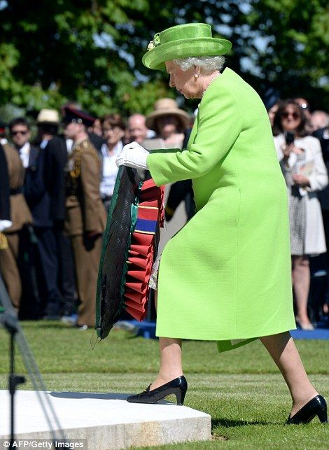 6/6/14.  Laying a wreath: The Queen leaves a tribute on the war memorial in Bayeux