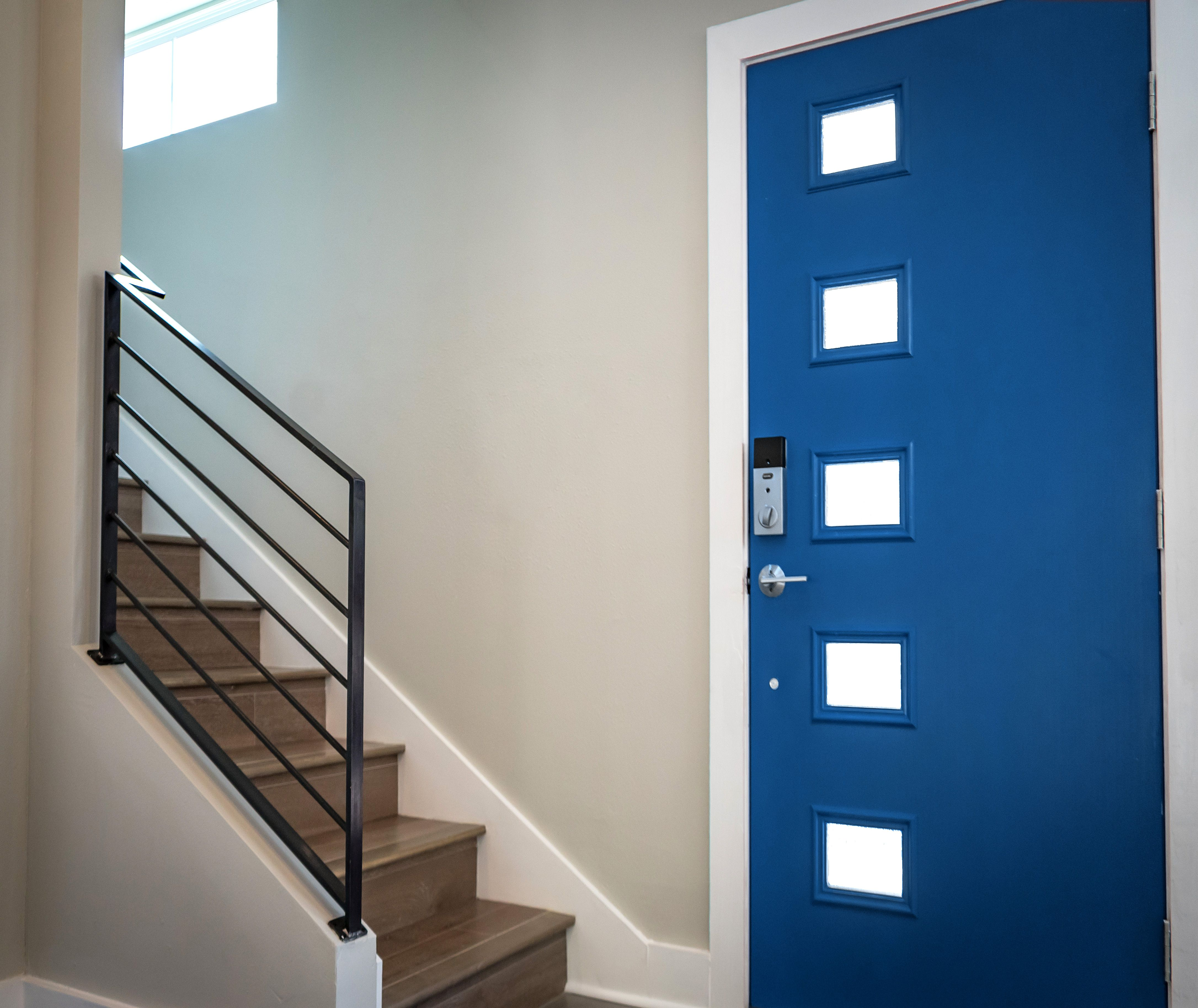 Accent your entryway with a modern fiberglass flush panel door with ...