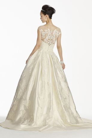 This Mikado ball gown hollywood glamour but with modern updates! stunning Mikado silk ball gown has a fitted bodice with illusion cap sleeves and neckline. Features elegant all-over lace applique adorned with seed beads and grand ball gown skirt with box pleats
